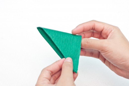 Fold the green crepe paper one more time and you should have a triangle like the one pictured.