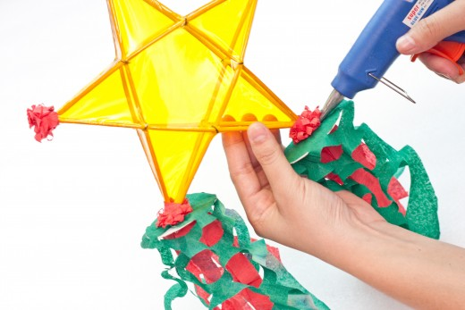 Place the hook at the pointed edge of the star and use your hot glue gun to secure it.