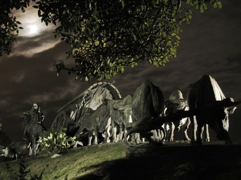 The Cart monument during a storm at night, situated in Batlle Park, Montevideo