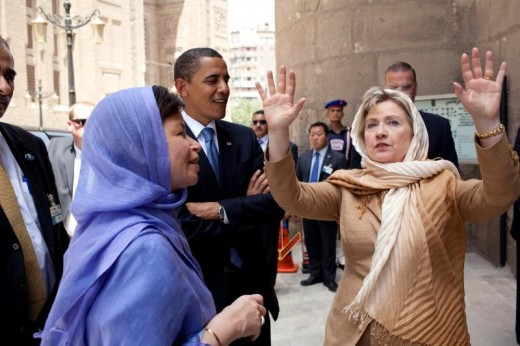 President Obama with Valarie Jarrett and Hillary Clinton both in headscarves