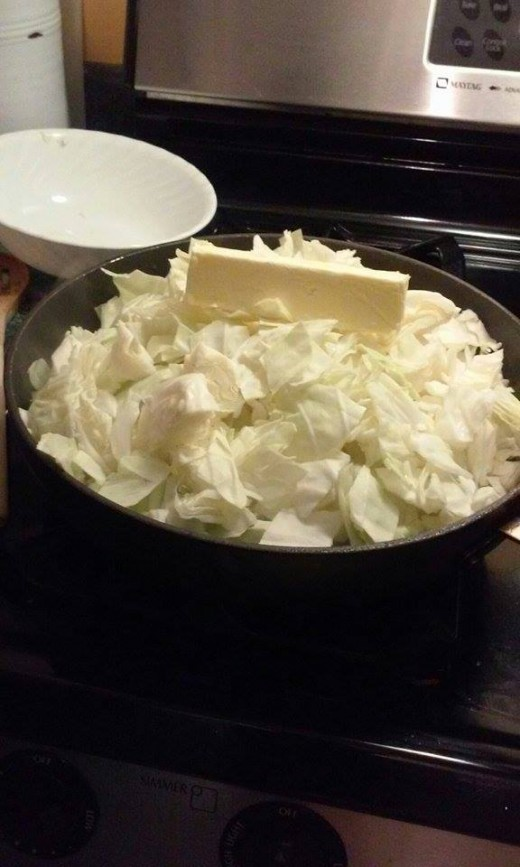 Place one stick of butter on top of chop cabbage and cook down