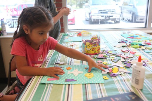 Kids work on their creative art and craft project at a Summer Club.