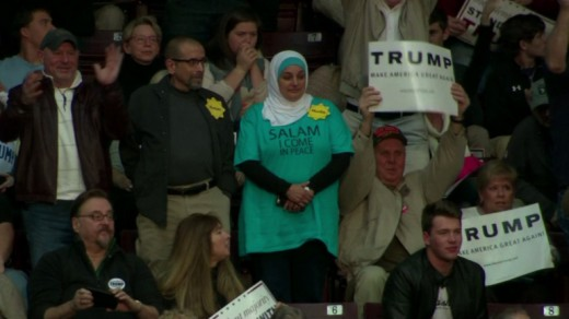 Rose Hamid, a Muslim woman, stands silently in protest against the hate rhetoric of Donald Trump.
