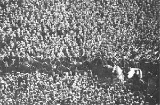 Billie the white horse clearing the crowd from the pitch.