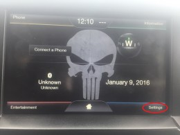 """Tap """"Settings"""" in the lower right corner of your Ford vehicle's SYNC with MyFord Touch home screen."""