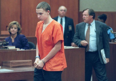 Joshua Phillips, 15, enters the courtroom April 22, 1999 for a hearing at which Circuit Judge Charles Arnold ordered the murder trial be moved to Bartow because of publicity.