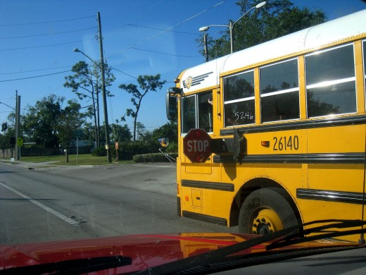 Yellow school bus with a white roof
