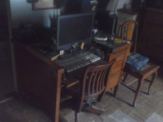 A very messy desk and a computer...the basic needs of any writer.