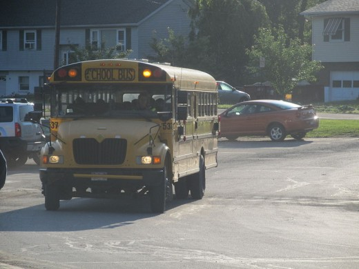yellow school bus using warning lights