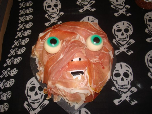 Skinned face made with ham and candy