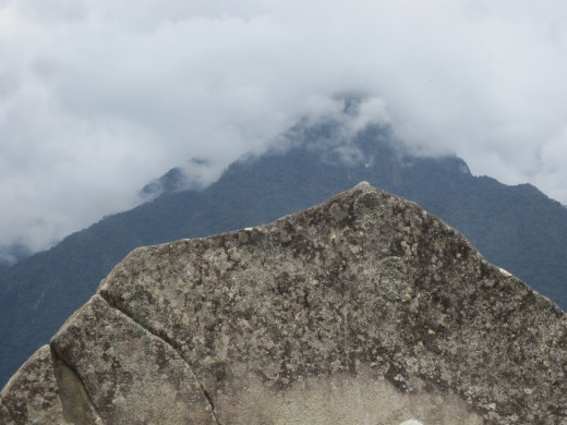 "The ""Sacred Rock"". When the clouds are gone you see the way this rock and the mountain called Cerro Pumasillo behind it are a lot alike."