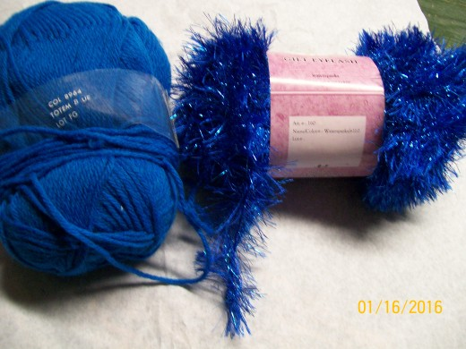 Blue acrylic matched with a fancy sparkle fuzzy yarn.