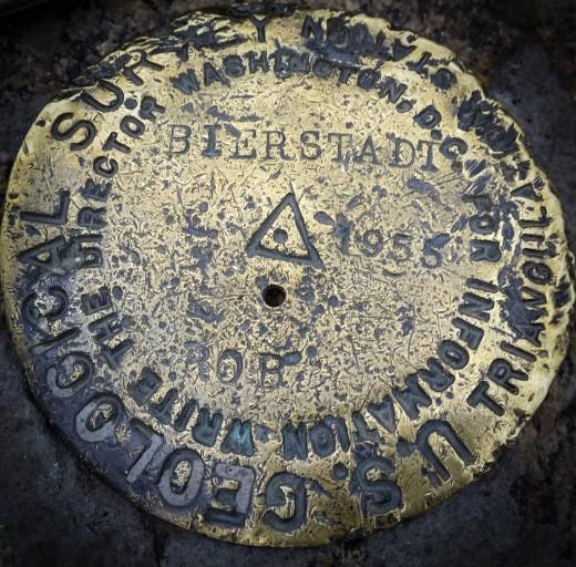 The well worn marker on top of Mt. Bierstadt
