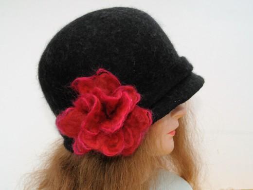 Hat with wispy flower