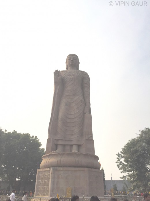 The Buddha Statue located before the site of Stupa