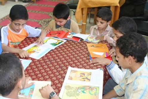 Children in a school in Egypt reading story books-Image of children reading