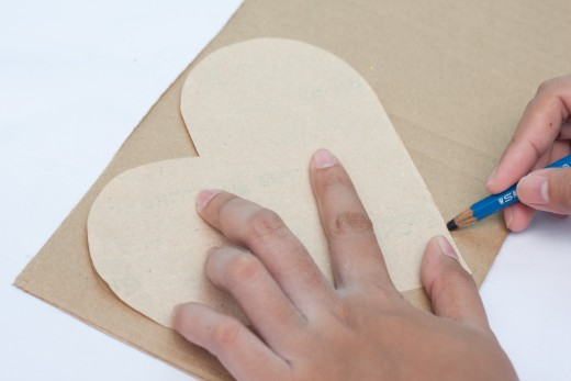 Use the pattern to trace a heart on the cardboard
