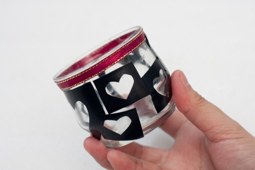 Stick the cut out hearts all over the candle jar