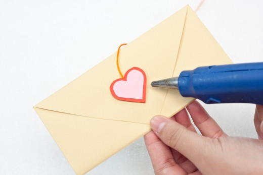 Glue the heart shape to the flap of your envelope