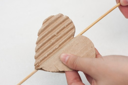 Split open your heart, peel into two pieces.  You are trying to get the bumpy edge on the corrugated cardboard so it will make a nice design on your homemade card