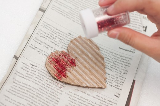 Sprinkle your red glitter all over the heart while the glue is wet