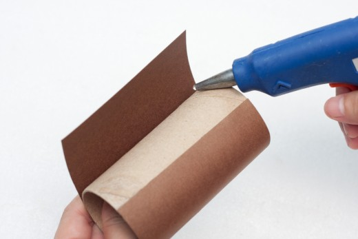 Glue brown construction paper to your cardboard craft roll