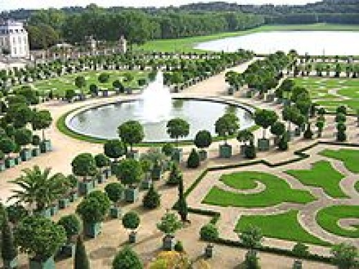 The Orangerie in the Gardens of Versailles with the Pièce d'Eau des Suisses in the background (French formal garden)