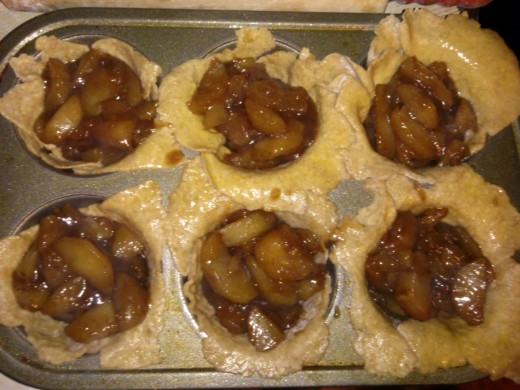 I start by filling all the tarts, then I work on folding over the dough.