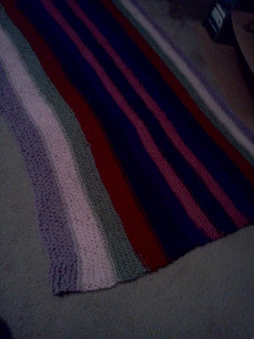This was my first big garter stitch project - an afghan! As I made it, I decided to make it multi-color to make it more interesting! My friend still loves and uses it years later!