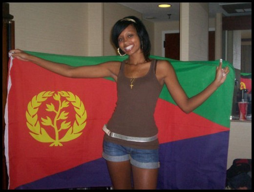 Woman carrying the Eritrean national flag