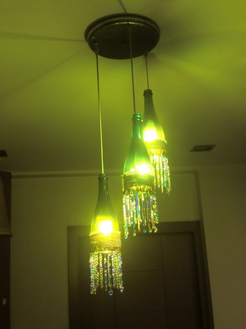 How to make a charming boho wine bottle chandelier in 4 for How to make a bottle chandelier
