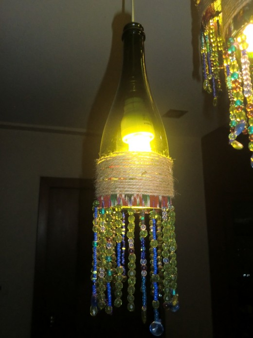 After wrapping the beaded cloth to the wine bottle, I wrapped the jute twine around the fabric part, of course with the help of a strong glue. This added to the boho-look of my chandelier apart from giving it a solid, finished look.