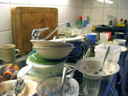 """Unwashed dishes in a sink; an authentic situation."""