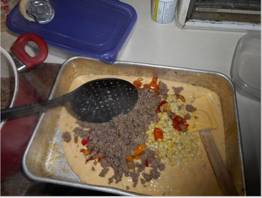 Put the sauce, sauteed onions and hamburger in your cake pan. Stir to mix.