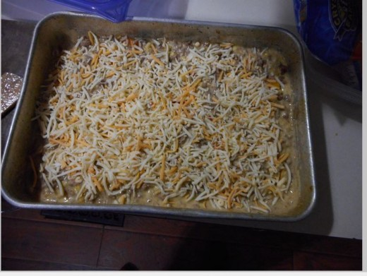 Shredded cheese across sauce mixture.