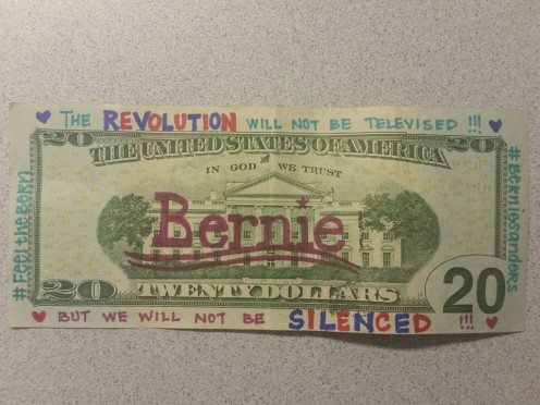 Jackie is obviously feeling the Bern, as she used different colors for alternating letters on these bills. I hope she put her kids to work helping her decorate these bills. The Bernie stamp is over the White House. Might be better in the white space.