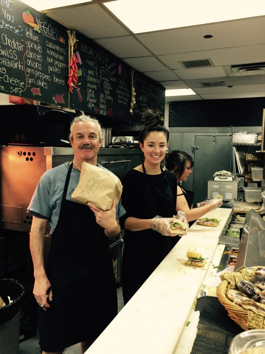 Owner Glen, serving up one of his infamous deli sandwiches with a smile!