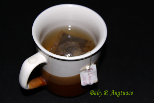 soaking or steeping used teabag