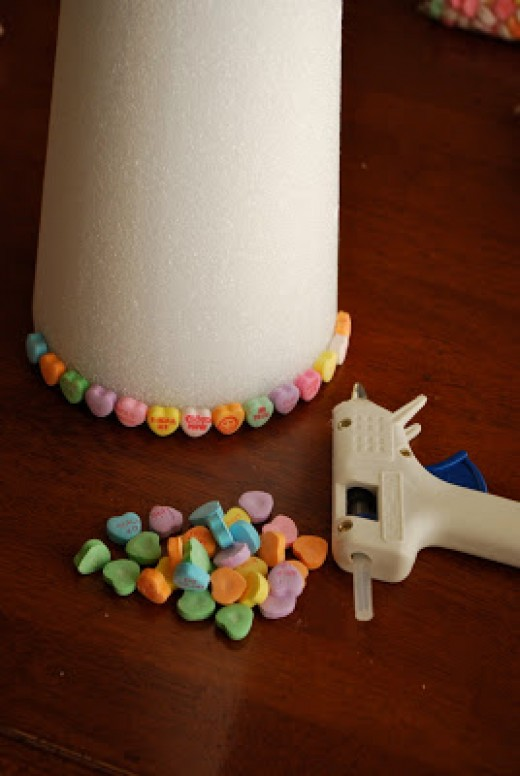Get a styrofoam tree, some glue, and lots of conversation hearts to make a fun and easy kids craft for Valentine's Day.  I bet the kids could make this while you are cooking your Valentine's Day lunch or dinner.