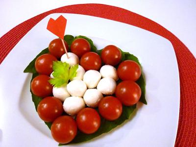 A Heart shaped mozzarella and tomato salad is a great way to begin your Valentine's Day dinner.