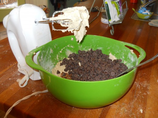 Beat the dry ingredients into the wet. Add the chocolate chips and nuts. Stir to mix thoroughly.