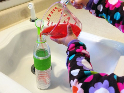 Allowing your child to pour in the vinegar helps engage