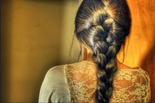 Start braiding from the top of your head to create an elegant French Braid.