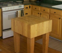 Another option is to have an entire countertop made of a butcher's block or incorporate a table devoted to chopping, like the one seen here.