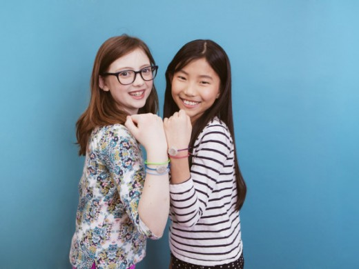 Young girls wearing friendship bracelets or Jewelbots