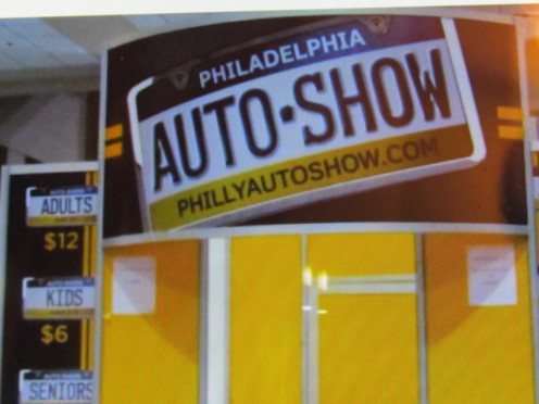 A poster from the Philadelphia Auto Show that was held at the Pa Convention Center.