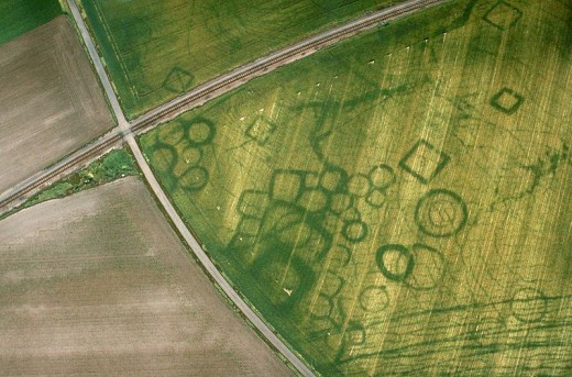 Cropmarks of a prehistoric necropolis at Grezac, France (photo by J. Dassie) - the dark lines are positive cropmarks showing the ditches surrounding the burial sites.