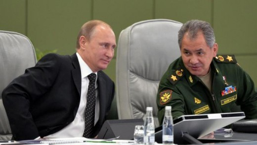 Here Vladimir can be seen conversing with his Defense Minister Sergei Shoigu.