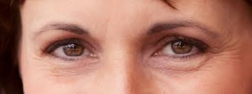 Wrinkled eyes - visible effect of aging