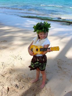 Our granddaughter playing the ukulele REK